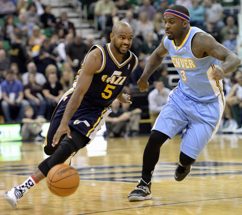 Rick Egan  | The Salt Lake Tribune   Utah Jazz point guard John Lucas III (5) drives on Denver Nuggets point guard Ty Lawson (3) in NBA action, Utah vs. The Denver Nuggets, in Salt Lake City, Monday, November 11, 2013.