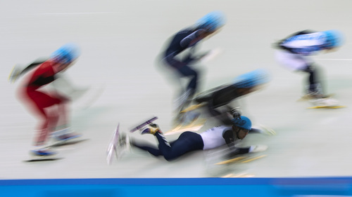 SOCHI, RUSSIA  - JANUARY 10: Jack Whelbourne, of Great Britain, falls while competing in the 1,500-meter short-track speedskating finals at Iceberg Skating Palace during the 2014 Sochi Olympic Games Monday February 10, 2014. (Photo by Chris Detrick/The Salt Lake Tribune)