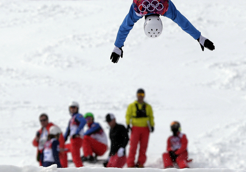 Anton Kushnir of Belarus jumps during freestyle skiing aerials training at the Rosa Khutor Extreme Park at the 2014 Winter Olympics, Monday, Feb. 10, 2014, in Krasnaya Polyana, Russia. (AP Photo/Andy Wong)