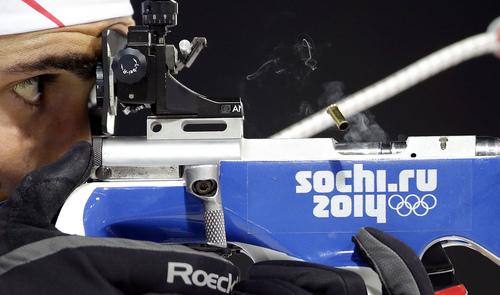 France's Martin Fourcade shoots during the men's biathlon 12.5k pursuit, at the 2014 Winter Olympics, Monday, Feb. 10, 2014, in Krasnaya Polyana, Russia. (AP Photo/Lee Jin-man)