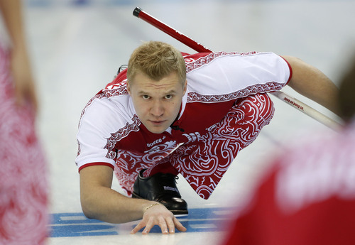 Russiaís skip Alexei Stukalsky watches his throw against Great Britain in men's curling at the 2014 Winter Olympics, Monday, Feb. 10, 2014, in Sochi, Russia. (AP Photo/Robert F. Bukaty)