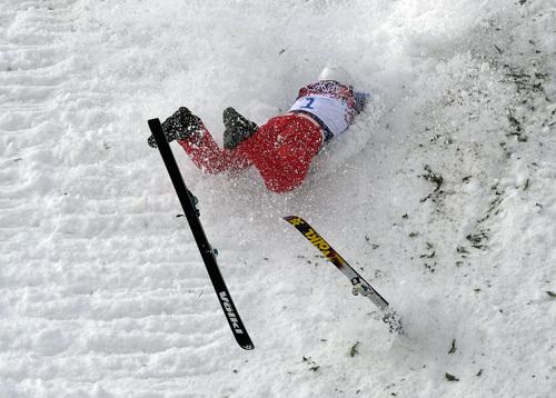 China's Liu Zhongqing crashes during freestyle skiing aerials training at the Rosa Khutor Extreme Park at the 2014 Winter Olympics, Monday, Feb. 10, 2014, in Krasnaya Polyana, Russia. (AP Photo/Andy Wong)