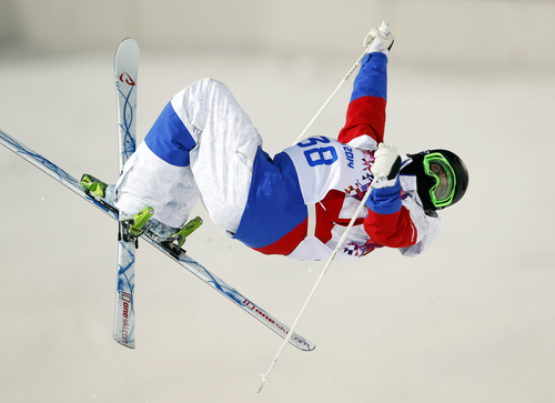 Russia's Aleksey Pavlenko jumps during the men's moguls qualifying at the Rosa Khutor Extreme Park at the 2014 Winter Olympics, Monday, Feb. 10, 2014, in Krasnaya Polyana, Russia.  (AP Photo/Sergei Grits)