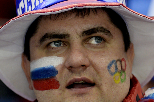 SOCHI, RUSSIA - FEBRUARY 10: A Russian fan watches the action between the U.S.A. and Switzerland during the second period of action at the Shayba Arena. Sochi 2014 Winter Olympics on Monday, February 10, 2014. (Photo by AAron Ontiveroz/The Denver Post)