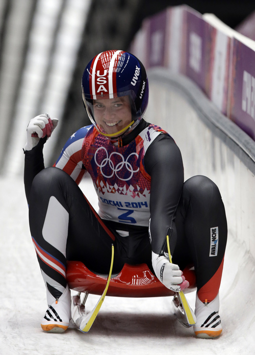 Kate Hansen of the United States brakes in the finish areas after her second run during the women's singles luge competition at the 2014 Winter Olympics, Monday, Feb. 10, 2014, in Krasnaya Polyana, Russia. (AP Photo/Dita Alangkara)