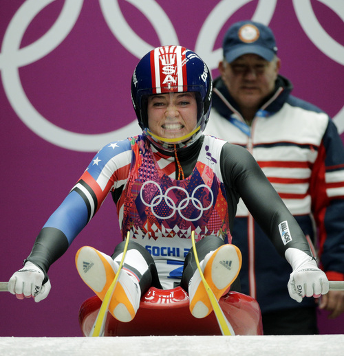Kate Hansen of the United States starts her first run during the women's singles luge competition at the 2014 Winter Olympics, Monday, Feb. 10, 2014, in Krasnaya Polyana, Russia. (AP Photo/Jae C. Hong)
