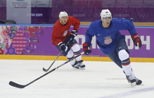 USA defenseman Ryan McDonagh, right, and forward Ryan Callahan run through a drill during a training session at the 2014 Winter Olympics, Monday, Feb. 10, 2014, in Sochi, Russia. (AP Photo/Julie Jacobson)