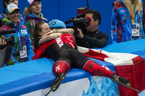 Chris Detrick  |  The Salt Lake Tribune  Charles Hamelin, of Canada, hugs Marianne St-Gelais after winning in the 1,500-meter short-track speedskating finals at Iceberg Skating Palace during the 2014 Sochi Olympic Games Monday Feb. 10, 2014.