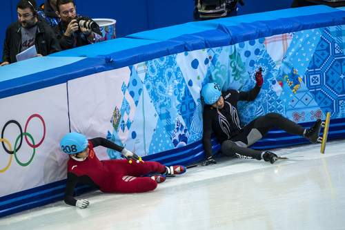 Chris Detrick  |  The Salt Lake Tribune  J.R. Celski, of Salt Lake City, and Dequan Chen, of China, (208) fall after finishing in the 1,500-meter short-track speedskating finals at Iceberg Skating Palace during the 2014 Sochi Olympic Games Monday Feb. 10, 2014. Celski finished in fourth place with a time of 2:15.624, 0.639 behind gold medalist Charles Hamelin of Canada.