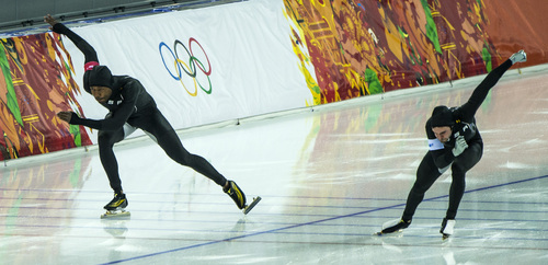 SOCHI, RUSSIA  - JANUARY 10: Shani Davis, of Chicago, Ill., and Mitch Whitmore, of Waukesha, Wis., compete in the long track men's 500m race at the Adler Arena Skating Center during the 2014 Sochi Olympic Games Monday February 10, 2014. Davis placed 24th with a time of 70.98. Whitmore placed 27th with a time of 71.06. (Photo by Chris Detrick/The Salt Lake Tribune)