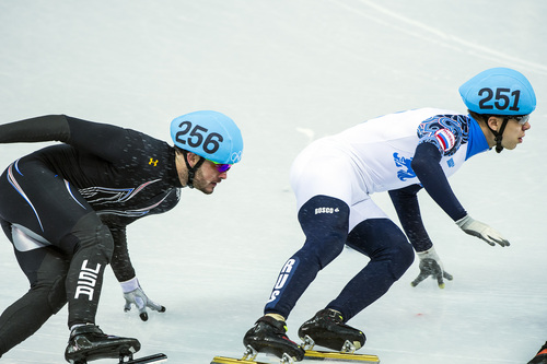 SOCHI, RUSSIA  - JANUARY 10: United State's Eduardo Alvarez and Russia's Semen Elistratov compete in the 1,500-meter short-track speedskating competition at Iceberg Skating Palace during the 2014 Sochi Olympic Games Monday February 10, 2014. (Photo by Chris Detrick/The Salt Lake Tribune)