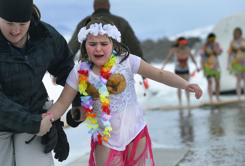 Scott Sommerdorf   |  The Salt Lake Tribune Eight year old Berkeley Stenquist is led away in tears after she learned the water was a lot colder than she expected after she made the plunge into the Hyrum Reservoir with her family. Participants in the Polar Plunge raised funds for Utah Special Olympics by jumping into the freezing water of the Hyrum reservoir, in Hyrum, Saturday, Feb. 8, 2014.