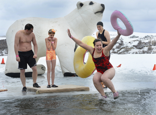 Scott Sommerdorf   |  The Salt Lake Tribune A group representing the Cache County Sheriff's Department makes the plunge into Hyrum Reservoir. Participants in the Polar Plunge raised funds for Utah Special Olympics by jumping into the freezing water of the Hyrum reservoir, in Hyrum on Saturday.