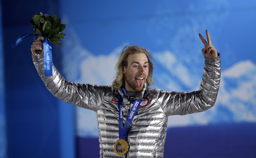 Gold medal winner Sage Kotsenburg acknowledges fans during the medal ceremony for the Snowboard Men's Slopestyle competition at the 2014 Winter Olympics, Saturday, Feb. 8, 2014, in Sochi, Russia. (AP Photo/David J. Phillip )