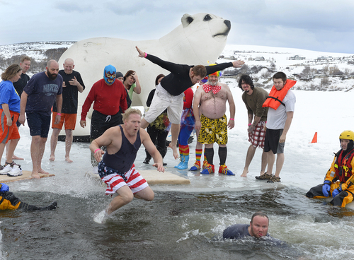 Scott Sommerdorf   |  The Salt Lake Tribune Participants in the Polar Plunge, including Jerry Morgan (in flag trunks)  raised funds for Utah Special Olympics by jumping into the freezing water of the Hyrum reservoir, in Hyrum, Saturday, Feb. 8, 2014.