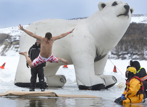 Scott Sommerdorf   |  The Salt Lake Tribune Jeff Boulware makes the most of his leap into the waters of Hyrum Reservoir. Participants in the Polar Plunge raised funds for Utah Special Olympics by jumping into the freezing water of the Hyrum reservoir, in Hyrum, Saturday, Feb. 8, 2014.