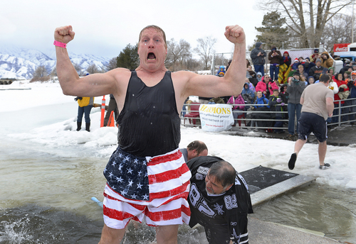 Scott Sommerdorf   |  The Salt Lake Tribune Jerry Morgan exults in his feat after emerging from the freezing water of Hyrum Reservoir. Participants in the Polar Plunge raised funds for Utah Special Olympics by jumping into the freezing water of the Hyrum reservoir, in Hyrum, Saturday, Feb. 8, 2014.