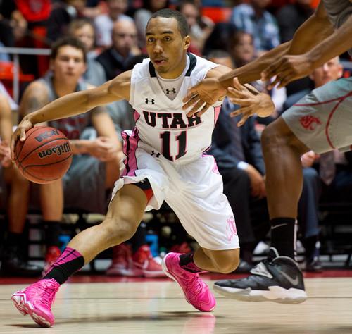 Trent Nelson  |  The Salt Lake Tribune Utah Utes guard Brandon Taylor (11) drives to the basket as the University of Utah hosts Washington State, NCAA basketball at the Huntsman Center Saturday February 8, 2014 in Salt Lake City.