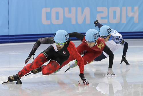 Charles Hamelin of Canada, left, Han Tianyu of China, centre, and Victor An of Russia compete in a men's 1500m short track speedskating final at the Iceberg Skating Palace during the 2014 Winter Olympics, Monday, Feb. 10, 2014, in Sochi, Russia. (AP Photo/Darron Cummings)