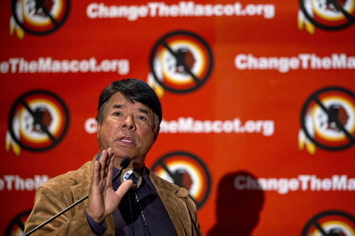 Ray Halbritter, national representative of the Oneida Indian Nation, gestures as he speaks during the Oneida Indian Nation's Change the Mascot symposium, Monday, Oct. 7, 2013, in Washington, calling for the Washington NFL football team to change its name. (AP Photo/Carolyn Kaster)