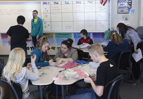 Al Hartmann  |  The Salt Lake Tribune Ninth-grade students in Tami Ewell's Language Arts class at Copper Mountain Middle School in Herriman work on a sentence structure lesson Wednesday Jan. 29, 2014. WPU (per student spending) increases in recent years haven't actually been enough in most cases to boost teacher pay or reduce class sizes. This year's WPU increase won't likely be enough either if lawmakers stick to the 2.5 percent increase being proposed by the governor.  Much of Jordan District's WPU increase this year was overshadowed by retirement costs and the costs of opening the new  Copper Mountain Middle School to accomodate enrollment growth.