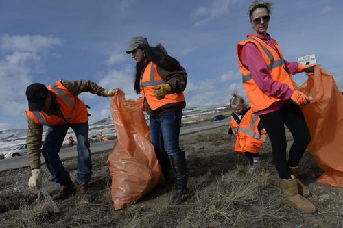 Francisco Kjolseth  |  The Salt Lake Tribune Volunteers Ryan Ellis, Blair Nastase, Devree Musbach, 3, and her mom Tracy, from left, decided to join the people from Restore The Fourth-Utah along with others who share their concerns of the NSA to pick up trash along Redwood Road outside the Utah Data Center in Bluffdale on Tuesday, Feb. 11, 2014. The clean up is meant to double as a protest against the NSA.