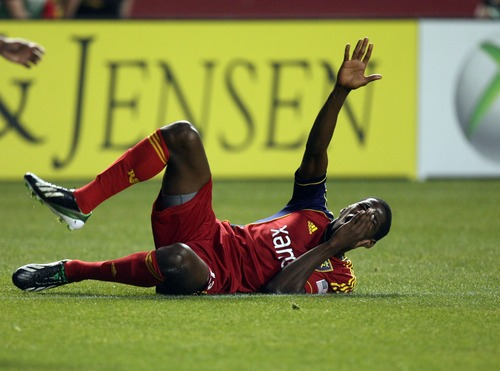 Kim Raff  |  The Salt Lake Tribune Real Salt Lake forward Olmes Garcia (13) rolls on the ground after catching a shoulder in the face during a game against the Los Angeles Galaxy at Rio Tinto in Sandy on April 27, 2013. Real Salt Lake lost the game 2-0.