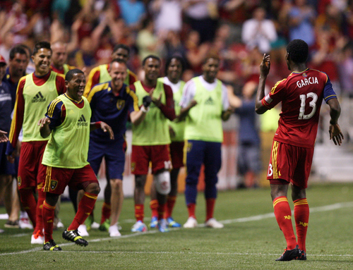 Kim Raff  |  The Salt Lake Tribune (right) Real Salt Lake forward Olmes Garcia (13) dances in front of the Real Salt Lake sideline after scoring a goal against the Los Angeles Galaxy during the second half at Rio Tinto Stadium in Salt Lake City on June 8, 2013.  Real went on to win the game 3-1.
