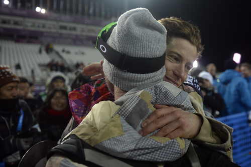ROSA KHUTOR, RUSSIA - FEBRUARY 11: Two-time defending gold medalist Shaun White hugs his longtime trainer Bud Keene after finishing fourth in the men's snowboard halfpipe final. Sochi 2014 Winter Olympics on Tuesday, February 11, 2014. (Photo by AAron Ontiveroz/The Denver Post)