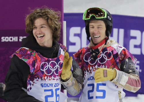 Switzerland's Iouri Podladtchikov, left, celebrates with Shaun White of the United States after  Podladtchikov won the gold medal in the men's snowboard halfpipe final at the Rosa Khutor Extreme Park, at the 2014 Winter Olympics, Tuesday, Feb. 11, 2014, in Krasnaya Polyana, Russia. (AP Photo/Andy Wong)