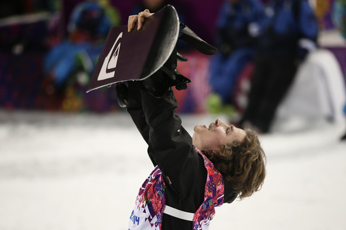 Switzerland's Iouri Podladtchikov celebrates after he won the gold medal in the men's snowboard halfpipe final at the Rosa Khutor Extreme Park, at the 2014 Winter Olympics, Tuesday, Feb. 11, 2014, in Krasnaya Polyana, Russia. (AP Photo/Jae C. Hong)