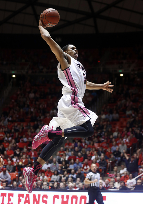 Utah guard Princeton Onwas goes in for a dunk on a breakaway against Washington State during the second half of an NCAA college basketball game in Salt Lake City, Saturday, Feb. 8, 2014. Utah won 81-63. (AP Photo/Jim Urquhart)