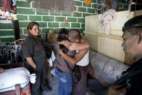In this Feb. 5, 2014, photo, Juan Corso embraces a relative at his home in Yautepec, Mexico. Corso, showed up after missing eight days and said he was kidnapped before making a deposit at a bank. Yautepec sits in the center a relatively prosperous and heavily populated stretch of suburbanizing countryside that stretches east from Cuernavaca, the capital of Morelos, the second-smallest of Mexico's 31 states and among the top five in kidnappings per capita, according to federal statistics. (AP Photo/Eduardo Verdugo)