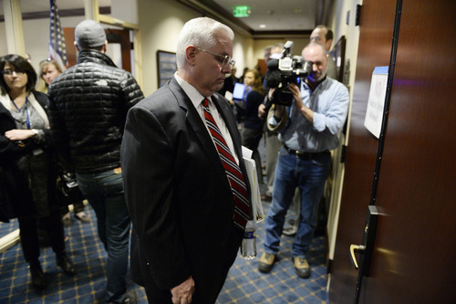 Francisco Kjolseth  |  The Salt Lake Tribune Senator Stuart Reid, R-Ogden, stands by the doors where moments before LGBT activists were arrested after blocking the doors to Senate committee room 210 at the Utah state Capitol on Monday, Feb. 9, 2014, in an effort to bring attention to anti-discrimination bill SB 100 with hopes of a hearing.