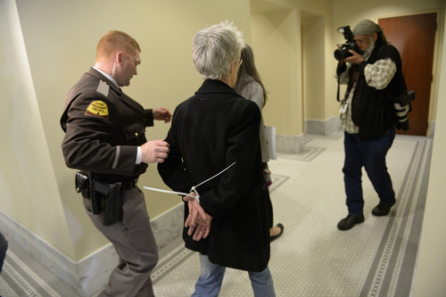 Francisco Kjolseth  |  The Salt Lake Tribune Gail Murdock is arrested along with other LGBT activists after blocking the doors to Senate committee room 210 at the Utah state Capitol on Monday, Feb. 9, 2014, in an effort to bring attention to anti-discrimination bill SB 100 with hopes of a hearing.