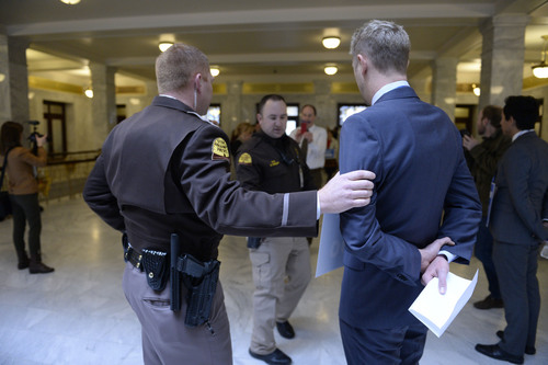 Francisco Kjolseth  |  The Salt Lake Tribune Activist Troy Williams is moved away from a group blocking the entrance to Gov. Gary Herbert's office at the Capitol on Monday, Feb. 9, 2014. The protesters pushed  to have anti-discrimination bill SB100 be heard. Thirteen were later arrested.