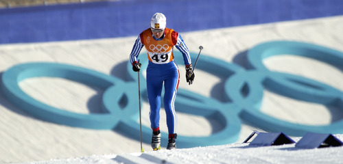 Al Hartmann  |  Tribune file photo  Russia's Olga Danilova skis up the first hill past the huge Olympic rings in the 10K Classical race at Soldier Hollow. She took second in the event behind Norway's Bente Skari.