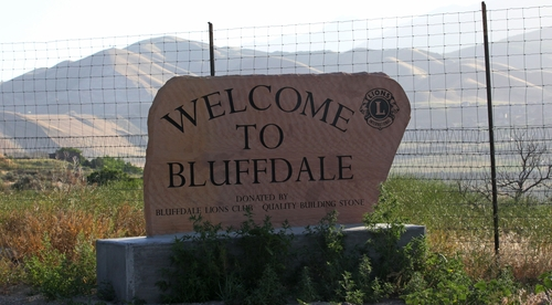 A welcome to Bluffdale sign is shown in front of Utah's NSA Data Center Wednesday, June 12, 2013,in Bluffdale, Utah. The nation's new billion-dollar epicenter for fighting global cyberthreats sits just south of Salt Lake City, tucked away on a National Guard base at the foot of snow-capped mountains. The long, squat buildings span 1.5 million square feet, and are filled with super-powered computers designed to store massive amounts of information gathered secretly from phone calls and emails. (AP Photo/Rick Bowmer)