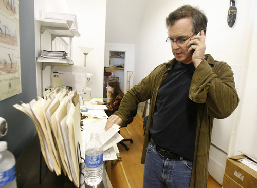 "Tribune file photo Doonesbury cartoonist Garry Trudeau, shown here in 2007 checking faxes of his comic strip sent to his editor, has announced he will take a hiatus from producing a daily strip to spend time writing and producing ""Alpha House."""