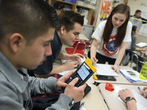 Keith Johnson | The Salt Lake Tribune  Jonathon Meza, left, Isaac Rodrigo Munoz and Crystal Williams use their Texas Instruments wireless calculators in Rob Lake's introduction to statistics class at Kearns High School, February 5, 2014 in Kearns, Utah. Each student has a calculator that transmits its data onto a screen for all to see. The Utah Legislature is looking into infusing millions of dollars for technology in Utah classrooms. Kearns High received a $1 million grant 3 years ago, allowing every student to get an iPod touch to help in the classroom. The results were mixed.