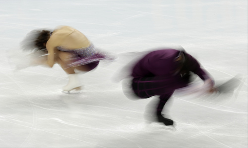 Meagan Duhamel and Eric Radford of Canada compete in the pairs free skate figure skating competition at the 2014 Winter Olympics, Wednesday, Feb. 12, 2014, in Sochi, Russia. (AP Photo/Bernat Armangue)