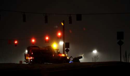 A snow plow clears a road in Chapel Hill, N.C., Wednesday, Feb. 12, 2014. The National Weather Service has issued a winter storm warning for Wednesday and into Thursday covering most of North Carolina. (AP Photo/Gerry Broome)