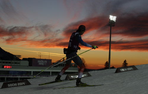 South Korea's Lee In-bok is silhouetted during a men's biathlon training session at the 2014 Winter Olympics, Wednesday, Feb. 12, 2014, in Krasnaya Polyana, Russia. (AP Photo/Lee Jin-man)
