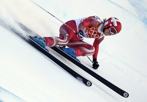 Switzerland's Dominique Gisin makes a turn in the women's downhill at the Sochi 2014 Winter Olympics, Wednesday, Feb. 12, 2014, in Krasnaya Polyana, Russia. (AP Photo/Charles Krupa)