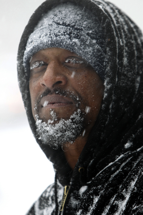 Snow clings to Turron Williams' beard and eyelashes Wednesday, Feb.11, 2014 on Hammond Road in Raleigh, N.C. Williams was helping push cars stuck in the snow.  (AP Photo/The News & Observer, Travis Long)