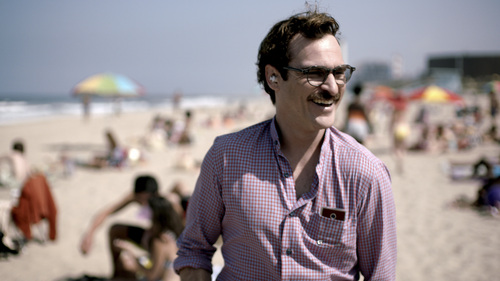 """FILE - This file image provided by Warner Bros. Pictures shows Joaquin Phoenix in a scene from """"Her."""" In ?Her,? Spike Jonze?s futuristic exploration of a man?s relationship with his computer, the filmmaker surveys human disjunction. (AP Photo/Warner Bros. Pictures, File)"""