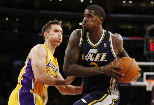Utah Jazz's Marvin Williams, right, drives past Los Angeles Lakers Steve Nash during the first half of an NBA basketball game in Los Angeles, Tuesday, Feb. 11, 2014. (AP Photo/Danny Moloshok)
