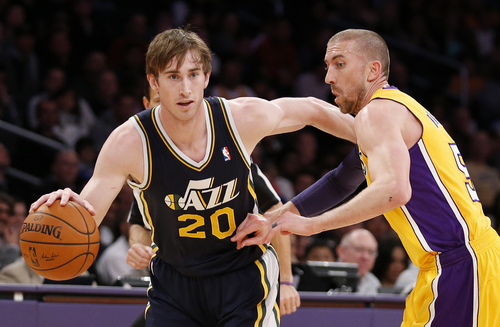 Utah Jazz's Gordon Hayward, left, drives past Los Angeles Lakers' Steve Blake during the first half of an NBA basketball game in Los Angeles, Tuesday, Feb. 11, 2014. (AP Photo/Danny Moloshok)