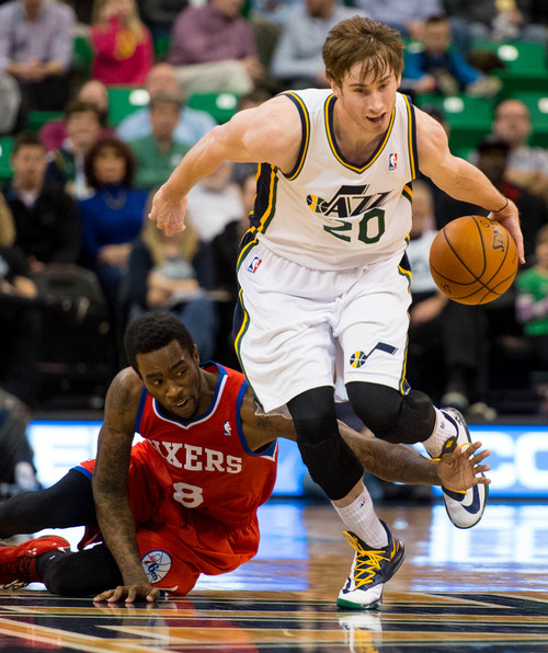 Trent Nelson  |  The Salt Lake Tribune Utah Jazz shooting guard Gordon Hayward (20) dribbles away from Philadelphia 76ers shooting guard Tony Wroten (8) as the Utah Jazz host the Philadelphia 76ers, NBA basketball at EnergySolutions Arena in Salt Lake City, Wednesday February 12, 2014.