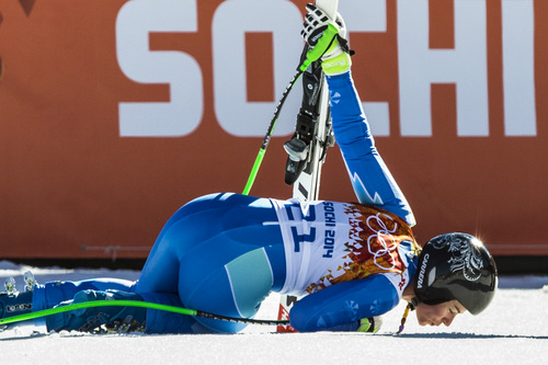 KRASNAYA POLYANA, RUSSIA  - JANUARY 12: Slovenia's Tina Maze kisses the snow after competing in the women's downhill race at Rosa Khutor Alpine Center Wednesday February 12, 2014. Maze tied for first place with a time of 1:41.57 with Switzerland's Dominique Gisin. (Photo by Chris Detrick/The Salt Lake Tribune)